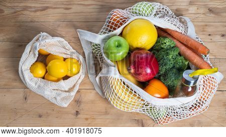 fresh fruits and vegetables in an eco bag. Zero waste, plastic free concept. Sustainable lifestyle. Reusable cotton and mesh eco bags for shopping