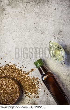 Linseed Oil In A Bottle, Flax Seeds, Salad Dressing In A Gravy Boat A Source Of Omega-3 Antioxidants
