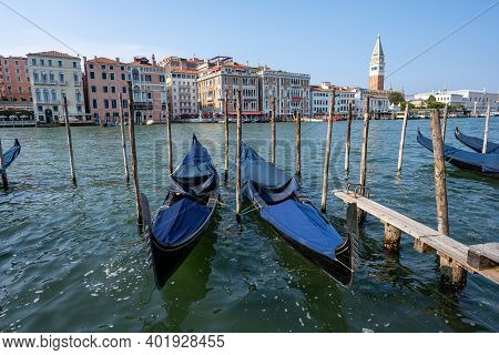 Gondolas At The Grand Canal In Venice With The Famous Campanile In The Back