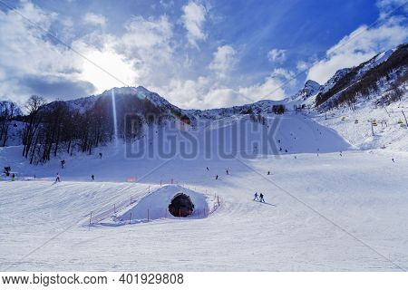 Sunlight Shines And Winter Ski Track For Skiers, Rosa Khotor Ski Resort In Russian Federation. Activ