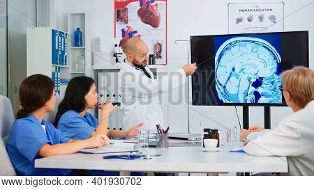 Experienced Man Doctor Analysing The Result Of Digital X-ray Image Together With Cvalified Colleague