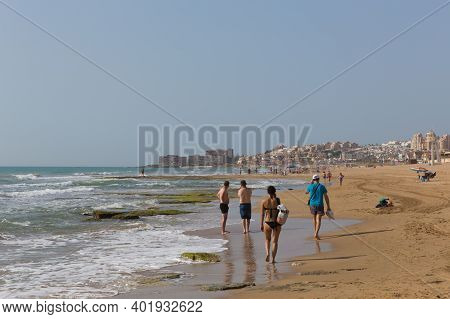 La Mata, Torrevieja, Spain-june 26th 2019: Holidaymakers And Visitors Enjoying A Walk On The Beautif