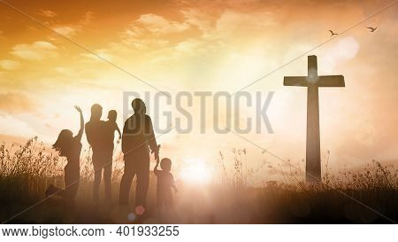Praise And Worship Concept: Silhouette Christian Family Looking For The Cross On Autumn Sunrise Back