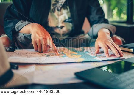 Close-up Tourist Planning Vacation With Map And Other Travel Accessories On The Table. Travel, Holid
