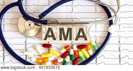 Wooden Blocks With The Inscription Ama With Stethoscope,pills On Grafs