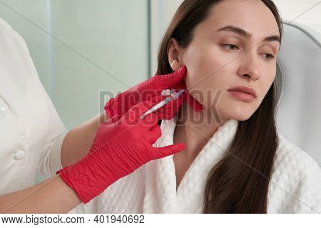 Cosmetologist Makes Lipolytic Injections To Burn Fat On The Chin Against Double Chin. Female Aesthet