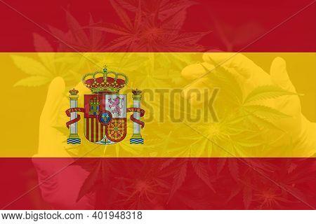 Cannabis Legalization In The Spain. Leaf Of Cannabis Marijuana On The Flag Of Spain. Medical Cannabi