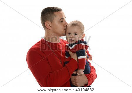 Young hispanic father kissing his son isolated on a white background