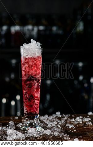 Close-up Soft Drink With Cherry And Ice In A Tall Glass, Pink Cold Cocktail With Ice In A Tall Glass