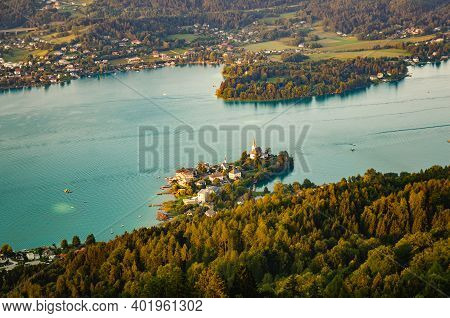 Village Maria Worth On The Lake Worthersee In Carinthia, Austria. Sunset Landscape