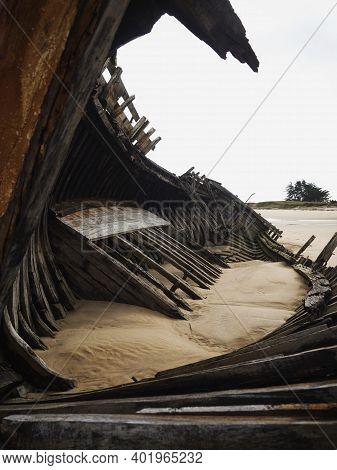 Stranded Broken Wooden Shipwrecks On Fishing Boat Naval Graveyard Marine Cemetery In Magouer Etel Ri