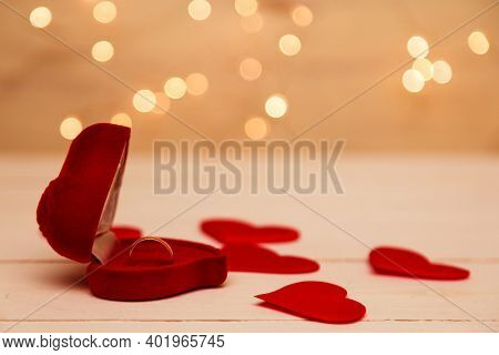 Gold Ring, Wedding Ring In Red Box And, Red Heart On White-red Background With Beautiful Bokeh. The
