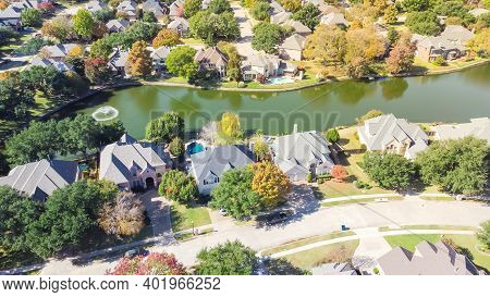 Aerial View Lakeside Houses With Water Fountain And Colorful Fall Foliage In Coppell, Texas, Usa