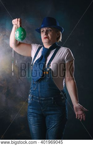 Woman With A Balloon In Her Hands. All The Air Came Out Of The Ball And It Hung On A Thread.