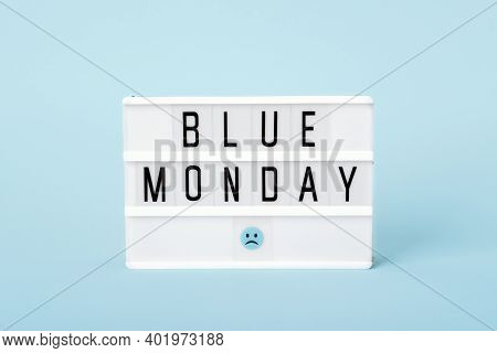 Blue Monday Concept. Light Board With Blue Monday Text And Sad Face On Blue Background