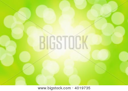 poster of Sun flares on a green natural abstract background.