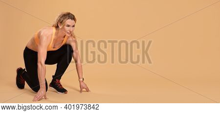 Jogging, Competition Or Marathon And Modern Adult Athlete. Muscular Focused Woman In Sports Uniform