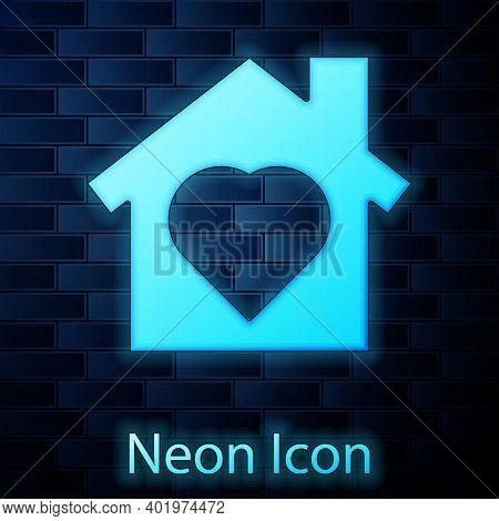 Glowing Neon House With Heart Inside Icon Isolated On Brick Wall Background. Love Home Symbol. Famil