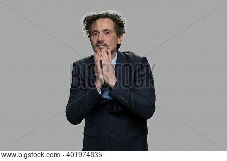 Crazy Stressed Businessman On Gray Background. Portrait Of Desperate Overhelmed Businessman. Human N