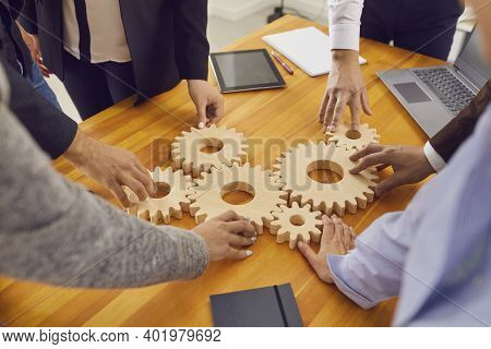 Company Workers Joining Gear Wheels As Metaphor For Effective Teamwork And Finding Working Solutions