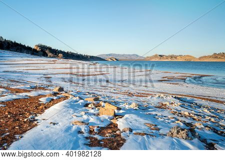 winter scenery of mountain lake at foothills of Rocky Mountains in afternoon light, Horsetooth Reservoir - a popular recreational area in northern Colorado