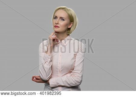 Beautiful Young Business Woman With Pensive Expression. Elegant Pensive Business Lady With Hand Unde