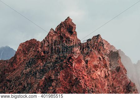 Surreal Pointed Rocky Pinnacle In Cloudy Sky. Vivid Big Pointy Rocky Peak. Giant Piece Of Stone. Atm