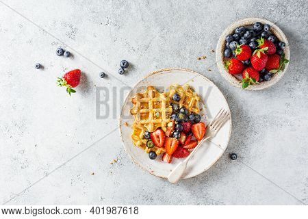 Homemade Belgian Waffles With Strawberries And Blueberries. Tasty Breakfast With Waffles.