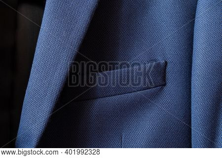 High Resolution With Details And Quality Shot Of Formal Dark Blue Wool Suit Fabric Texture. With Fro