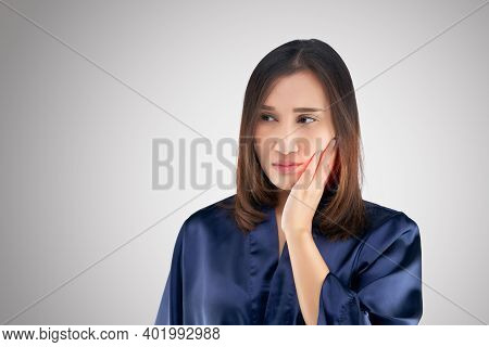 Suffering From Toothache. Beautiful Young Woman Suffering From Toothache While Standing Against Grey