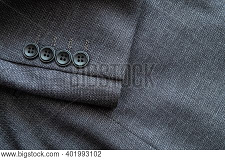 High Resolution With Details And Quality Shot Of Formal Black Or Dark Grey Wool Suit Fabric Texture.