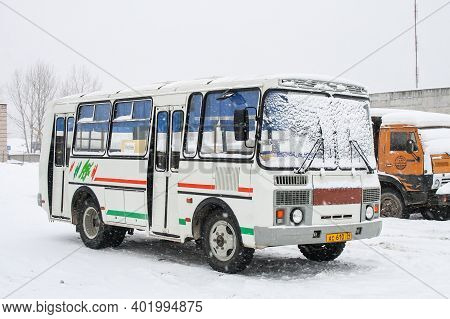 Asha, Russia - December 30, 2009: Snow Covered Suburban Bus Paz 32054 In The City Street.