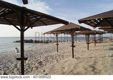Straw Beach Umbrellas. The Shore Of The Sea Of Azov. Ukraine