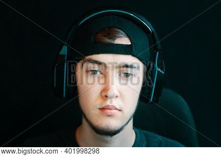 Streamer And Gamer Concept. Cyber Sport. Young Handsome Gamer Trying Hard To Win A Round. The Guy Wi