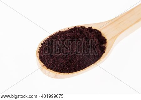 Wooden Spoon With Powder Of Fruit And Acai - Euterpe Oleracea; Photo On White Background.