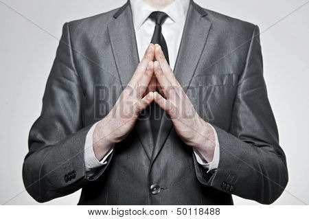 Businessman With Hands Folded Together