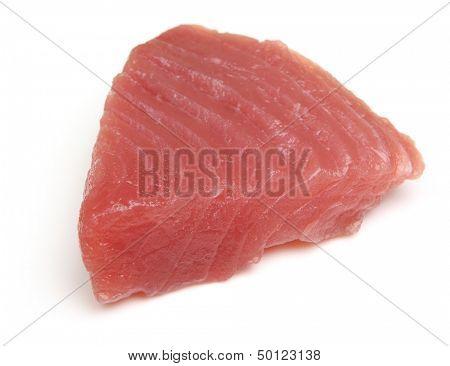 Raw tuna fish steak on white background.
