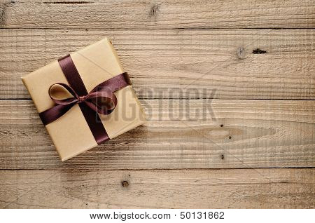 Vintage Gift Box With Bow On Wooden Background