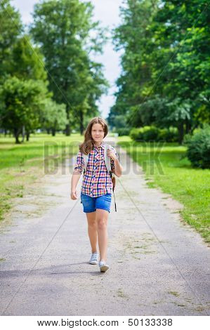 Pretty Teenager Girl In Casual Clothes Going To School On Sunny September Day, Outdoor Portrait