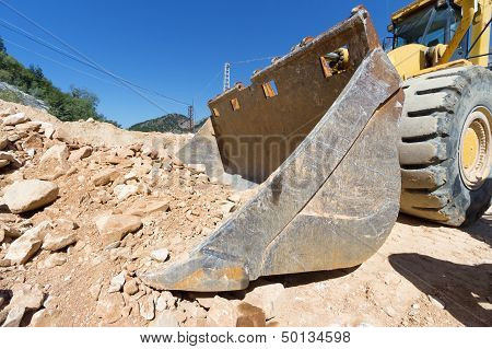 Excavator At Work On Site