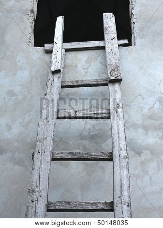 Old Wooden Vintage Cuve Ladder Near A Wall