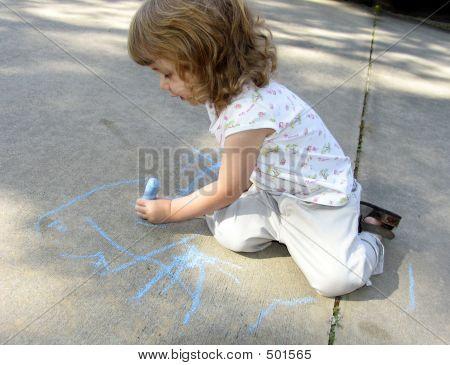 Child Drawing On Sidewalk