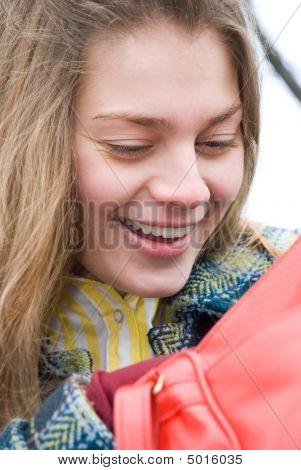 Woman Looking In Handbag