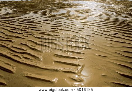Background pattern of wet sand ripples on a beach poster