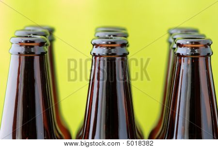 Empty Beer Bottles In Front Of Green