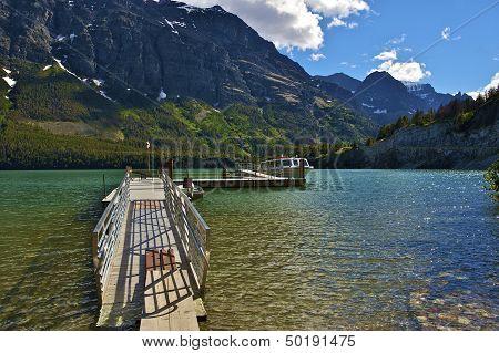 Saint Mary Lake Glacier National Park Montana U.S.A. Turists Boat on the Lake. Boats Dock. poster