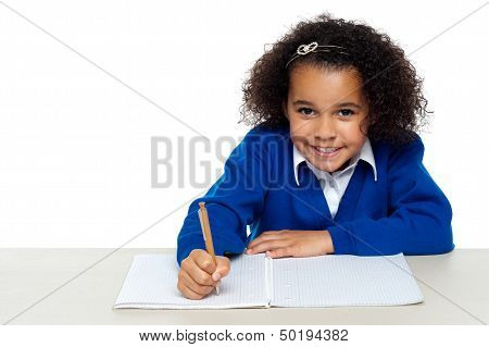 Cute Primary Kid Writing Her Assignment