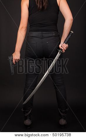 Woman With Gun And Sword