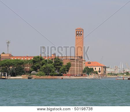 High Red Brick Bell Tower On The Island Of Sant'elena In Venice