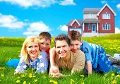 Happy family. Father mother and sons on the green grass poster